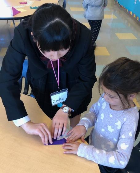Japanese vistors teach origami